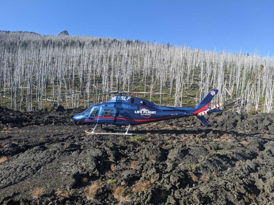 HIKERS RESCUED NEAR GEORGE LAKE